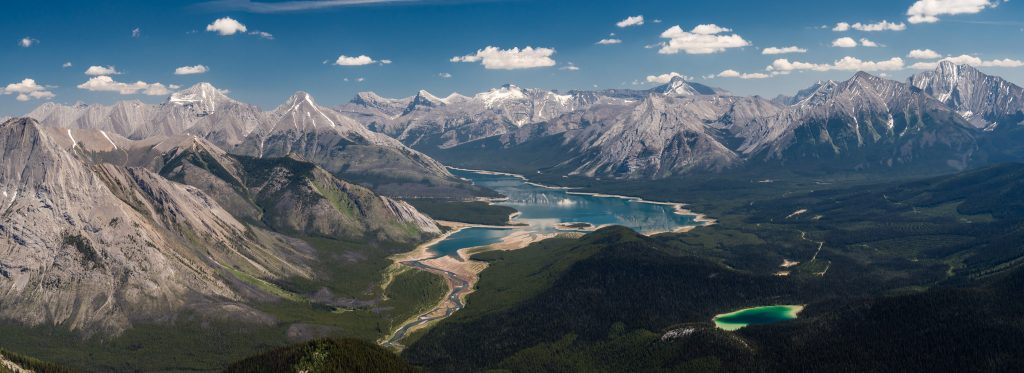 A panorama over Watridge and Spray Lakes includes from L to R, Fortune, Old Goat, Nestor, Lougheed, Sparrowhawk, Buller, Bogart, Engadine and Tower.