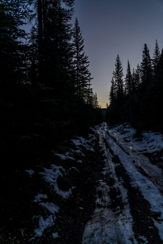 Biking an icy section of the Ghost River Road at predawn.