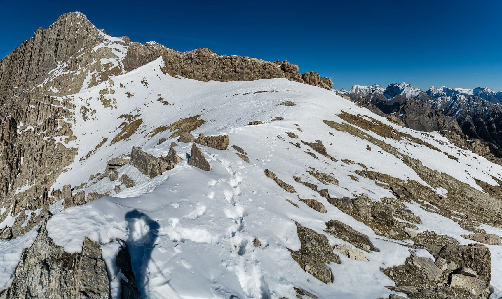 Looking ahead to the false summit at left. Note the rock wall just ahead.