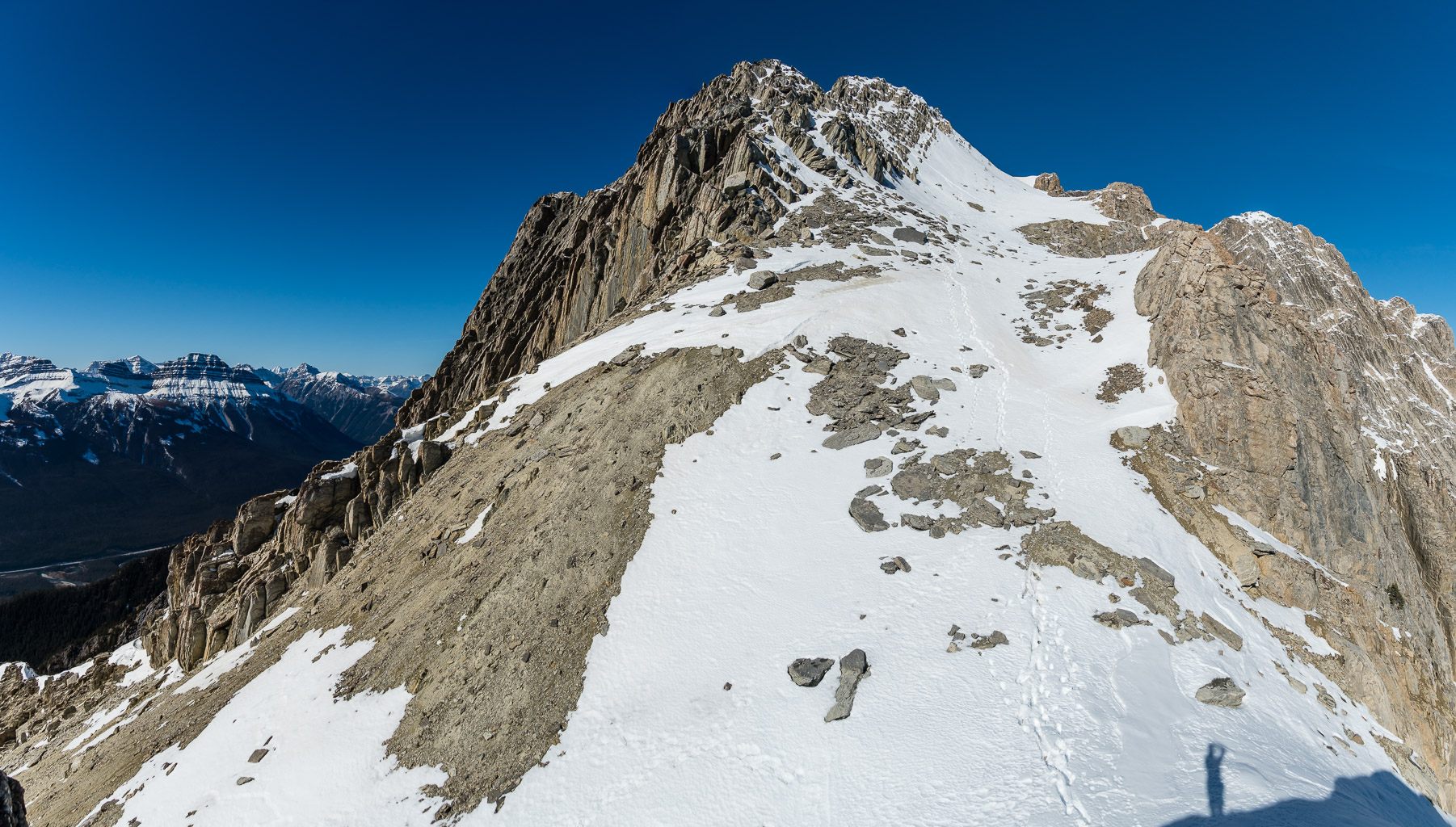 From on top of the small rock wall looking to the false summit.