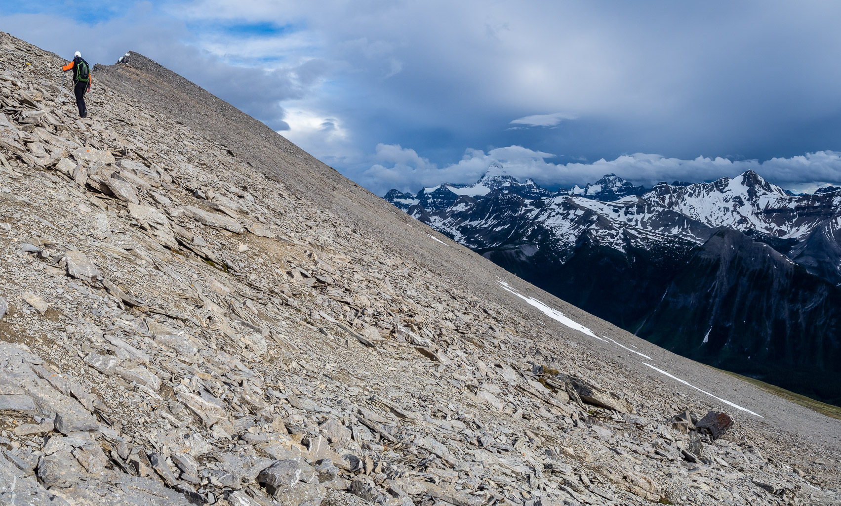 Surreal lighting as we continue to work our way along the never ending summit ridge of Golden Mountain - Assiniboine still showing at center distance.